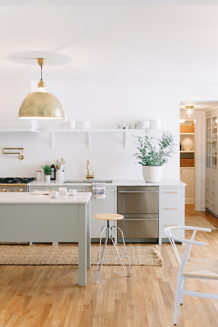 A beautiful kitchen with gold pendant light