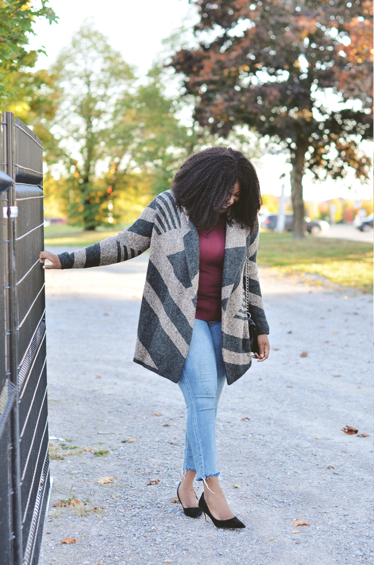 Raw denim jeans womens- Assa-cisse wearing a cozy coatigan perfect for fall.